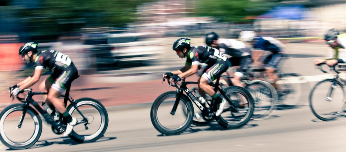 cyclists cycling fast